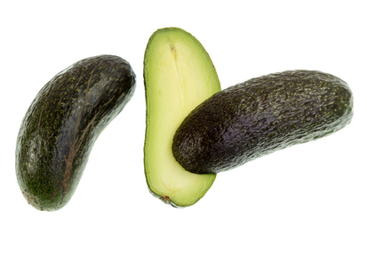 Seedless avocado, Persea americana, is a green skinned, fleshy body fruit with an elongated shape and without any seed.